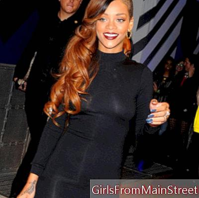 Sexy Rihanna in black dress slit in London